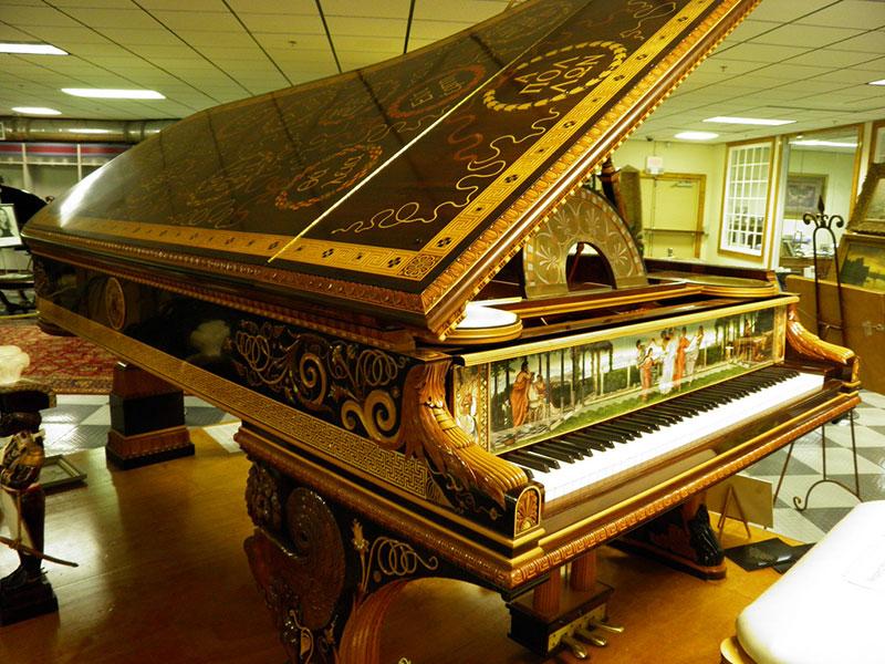 đàn piano mạ vàng