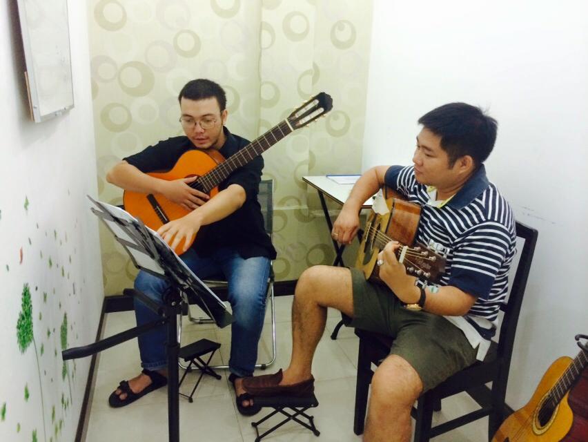 dạy guitar
